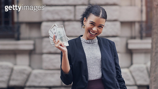 Cropped portrait of an attractive young businesswoman smiling while holding a stack of money while standing outdoors in the city - gettyimageskorea