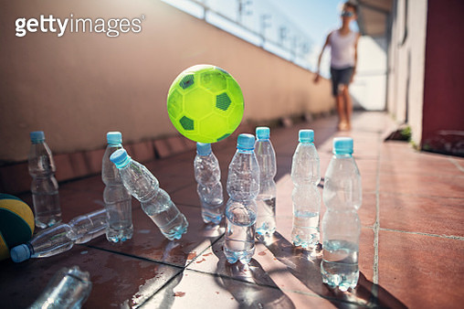 Kids playing ad hoc bowling on balcony - gettyimageskorea