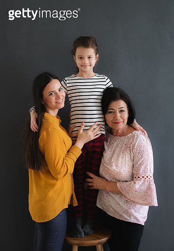 Three generations of women indoors, looking at camera. - gettyimageskorea