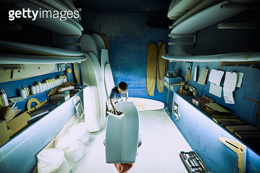 Surfboard shaper file down the rough edges in workshop for legendary Surfer - gettyimageskorea