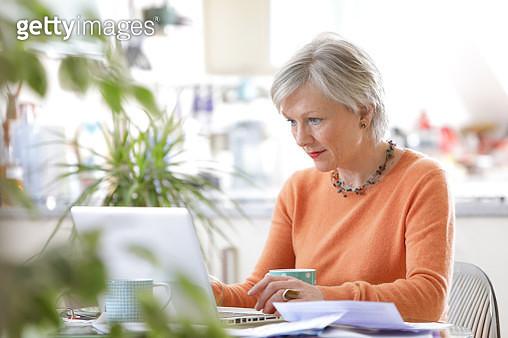 Older woman working on laptop - gettyimageskorea