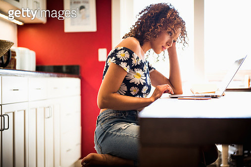 Young woman using laptop - gettyimageskorea