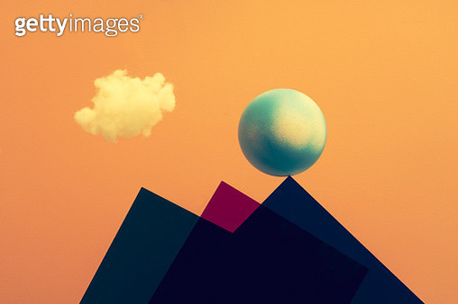 Earth balancing on a peak, symbolizing the fragile nature of our planet, a cloud is approaching - gettyimageskorea