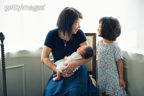 grand mother holding her grand son - gettyimageskorea