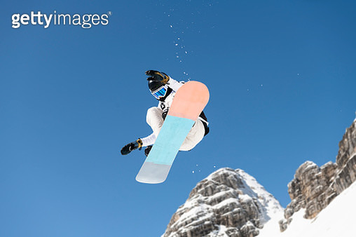 Shot of Young Snowboarder Practicing Big Air - gettyimageskorea