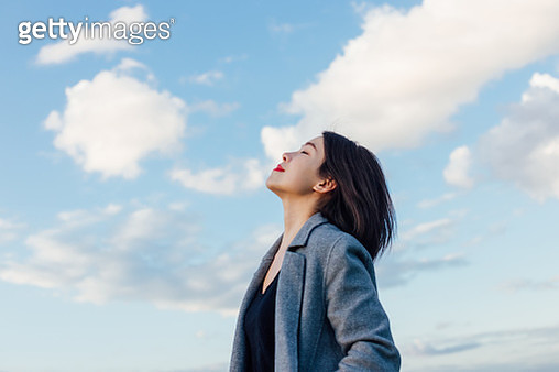 Young Lady Embracing Hope And Freedom - gettyimageskorea