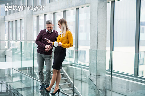 Mature businessman and young businesswoman having break from work. - gettyimageskorea