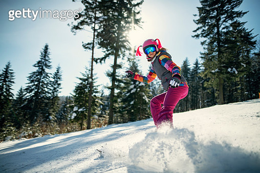 Little girl skiing on a sunny winter day - gettyimageskorea