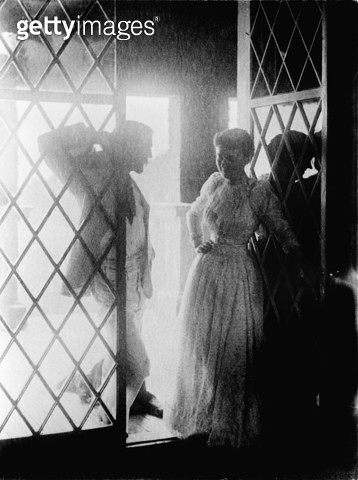COUPLE IN DOORWAY. /nMan and woman at a doorway to a porch. Photograph by Emma Justine Farnsworth, late 19th or early 20th century. - gettyimageskorea