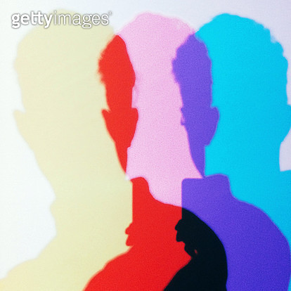 The triple silhouettes of a man's head and shoulders are seen overlapping as they are projected by a series of three lenses, one each in magenta, cyan and yellow.  The overlapping areas of the silhouettes combine the colors to show the effect of additive  - gettyimageskorea