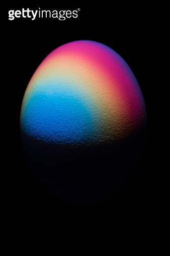 Colorful Spectrum Casting a Egg in the Dark, Black Background. - gettyimageskorea