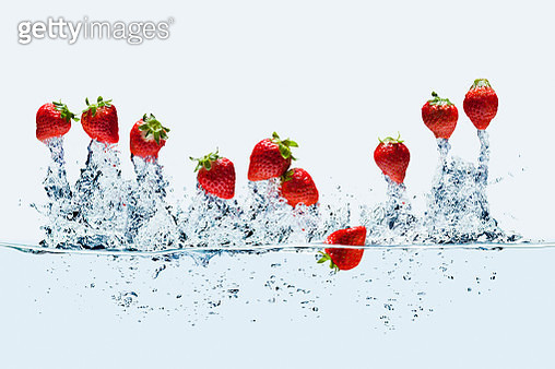 Strawberrys Jump out from water. - gettyimageskorea