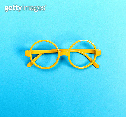 Round glasses on a bright blue background - gettyimageskorea