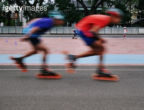Blurred Motion Of Boys Inline Skating - gettyimageskorea