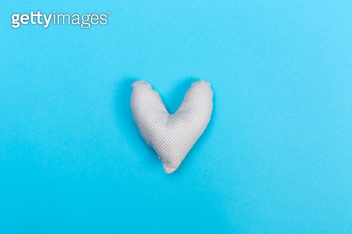 Handmade heart cushions on blue - gettyimageskorea