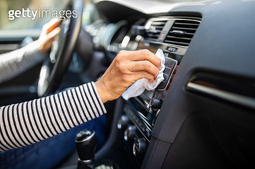 Female hands cleaning and disinfecting her car interior - gettyimageskorea