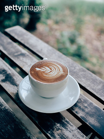High Angle View Of Coffee Cup Served On Wooden Table - gettyimageskorea