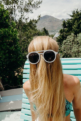 Oddball portrait of blond hair brushed forwards with sunglasses over - gettyimageskorea