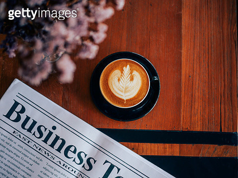 High Angle View Of Coffee Cup With Newspaper On Wooden Table In Cafe - gettyimageskorea