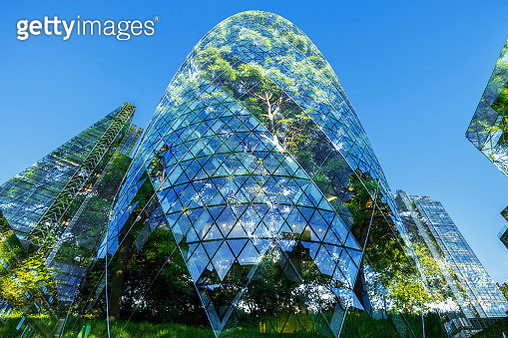 Abstract of city skyscrapers and trees - gettyimageskorea