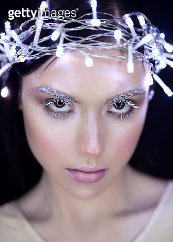 Face shot of girl with christmas lights on head - gettyimageskorea