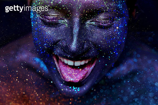Face shot of Girl in glitter laughing - gettyimageskorea