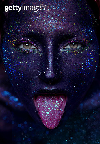 Shiny Girl in glitter sticks out tongue - gettyimageskorea