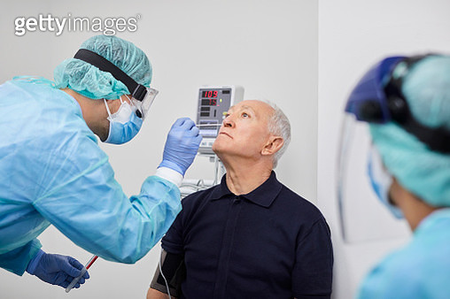 Doctor Taking Coronavirus Sample From Male's Nose, PCR. - gettyimageskorea