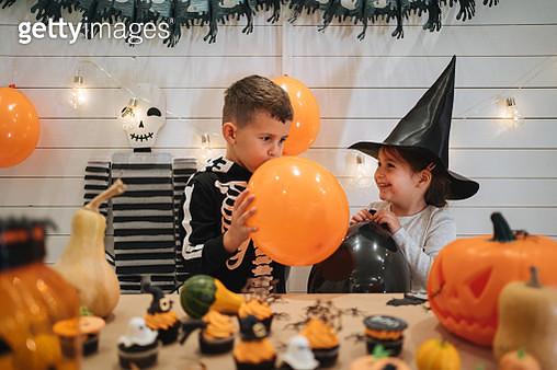 Halloween balloon blowing - gettyimageskorea