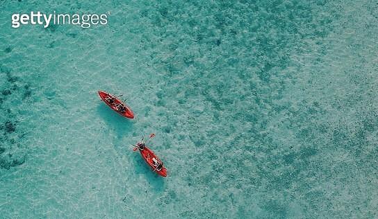 Aerial View Of People Kayaking In Sea - gettyimageskorea