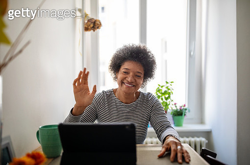 Mature woman doing a video call during home quarantine - gettyimageskorea