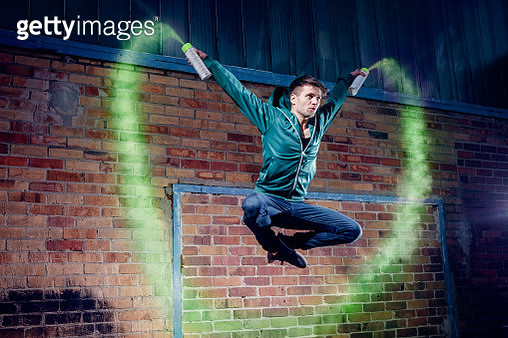 Male modern dancer performing with spray paint - gettyimageskorea