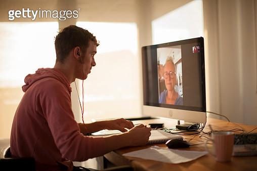 Student on videocall on computer during lockdown - gettyimageskorea