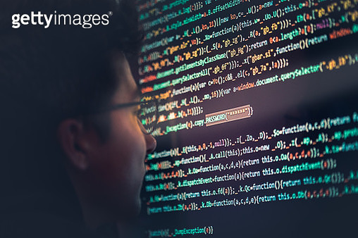 Side View Of Programmer Looking At Binary Code In Office - gettyimageskorea