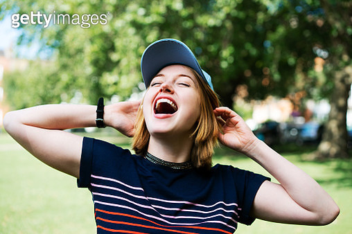 Happy woman with arms up full of life - gettyimageskorea