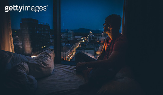 Relaxing by the window at night - gettyimageskorea