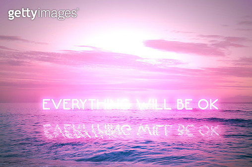 Everything will be ok message during covid pandemic with neon lights in sunset seascape. - gettyimageskorea