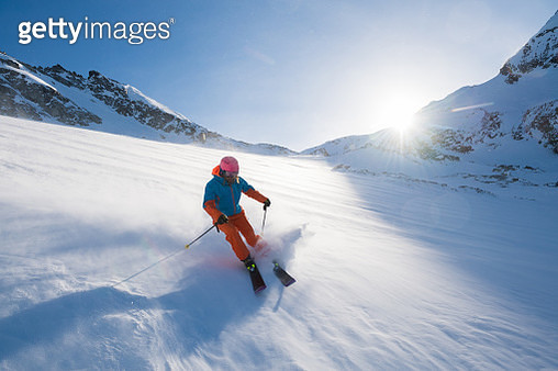 Skiing on a sunny day - gettyimageskorea
