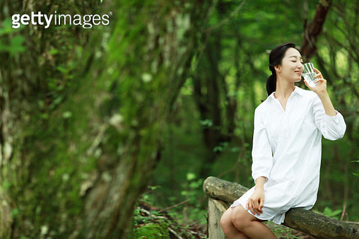 Young woman drinking glass of water - gettyimageskorea