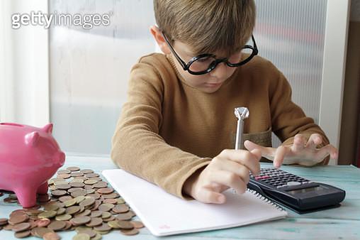 Boy Counting Savings. Financial Crisis Concept - gettyimageskorea