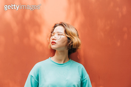 portrait of fashion real young Asian woman with glasses - gettyimageskorea