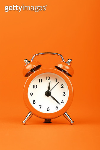 Close-Up Of Alarm Clock Against Orange Background - gettyimageskorea