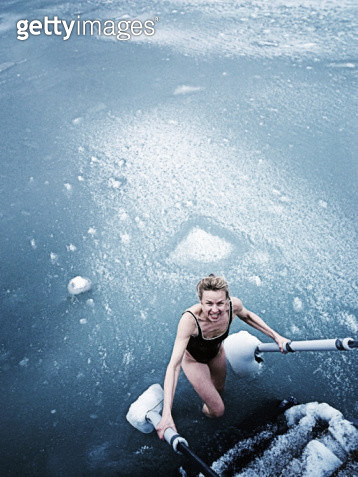 A woman viking comes up from bathing in the frozen sea at Vedbaek. - gettyimageskorea