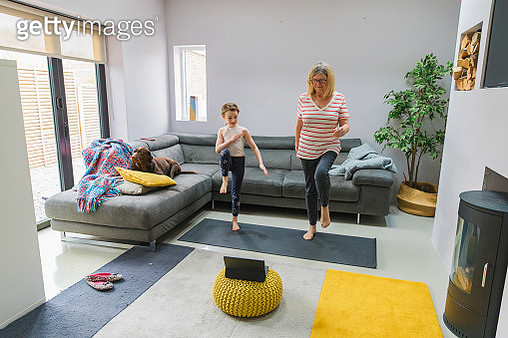 Senior lady exercising indoors with her granddaughter - gettyimageskorea