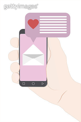 Hand holding smartphone with heart emoji message on screen, like button. - gettyimageskorea
