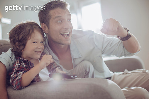 Father and son watching football - gettyimageskorea