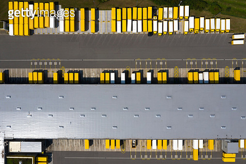 Aerial view of cargo containers, semi trailers, industrial warehouse, storage building and loading docks, Bavaria, Germany - gettyimageskorea