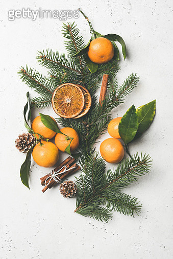 Christmas composition with fir tree, tangerines, cinnamon - gettyimageskorea