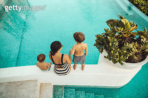 Mother with children at the pool - gettyimageskorea