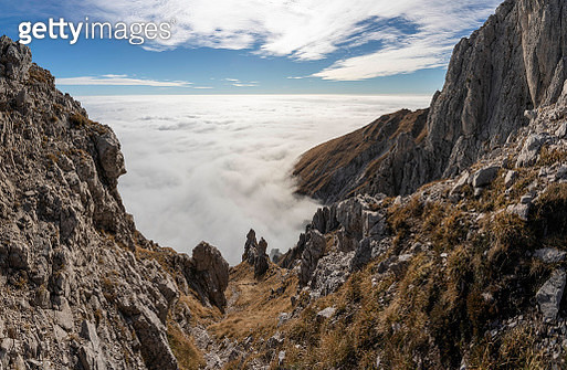 High mountain valley landscape, clear sky above the sea of clouds - gettyimageskorea